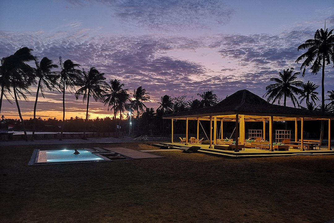 Sunset over the swimming pool & lounge